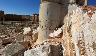 The Bel Temple in the ancient city of Palmyra is marred by graffiti and other damage, but archaeologists say it can be restored without resorting to extensive rebuilding using modern materials that might destroy its character. (Associated Press)