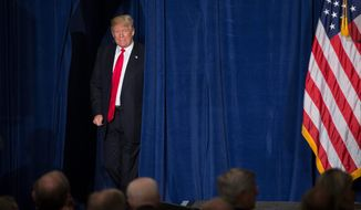 Donald Trump may have gone a long way toward bridging a gap between neoconservatives who have pushed for military intervention and traditional conservatives who argued the only way to export democracy is to remain a shining city on the hill. (Associated Press)