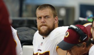 Washington Redskins offensive guard Brandon Scherff (75) watches from the bench during the second half of an NFL football game against the Chicago Bears, Sunday, Dec. 13, 2015, in Chicago. (AP Photo/Charles Rex Arbogast)