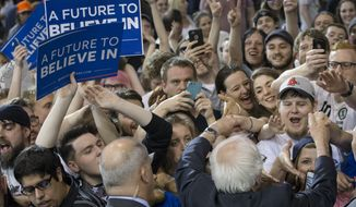 Democratic presidential candidate Sen. Bernie Sanders, I-Vt., greets with audience members during an election night campaign event at the Big Sandy Superstore Arena, Tuesday, April 26, 2016, in Huntington, W.Va. (AP Photo/John Minchillo)