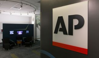 A logo for The Associated Press is seen at its headquarters in New York on Tuesday, April 26, 2016. AP's earnings rose 30 percent last year as the news cooperative recorded a huge tax gain and cut costs to help offset a revenue downturn reflecting the long-running financial woes plaguing newspapers and other media. (AP Photo/Hiro Komae)
