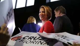 Former Hewlett-Packard CEO Carly Fiorina pauses as she signs campaign posters following a rally for Republican presidential candidate Sen. Ted Cruz, R-Texas, in Indianapolis, Wednesday, April 27, 2016.  Cruz chose Fiorina as his running mate.  (AP Photo/Michael Conroy)