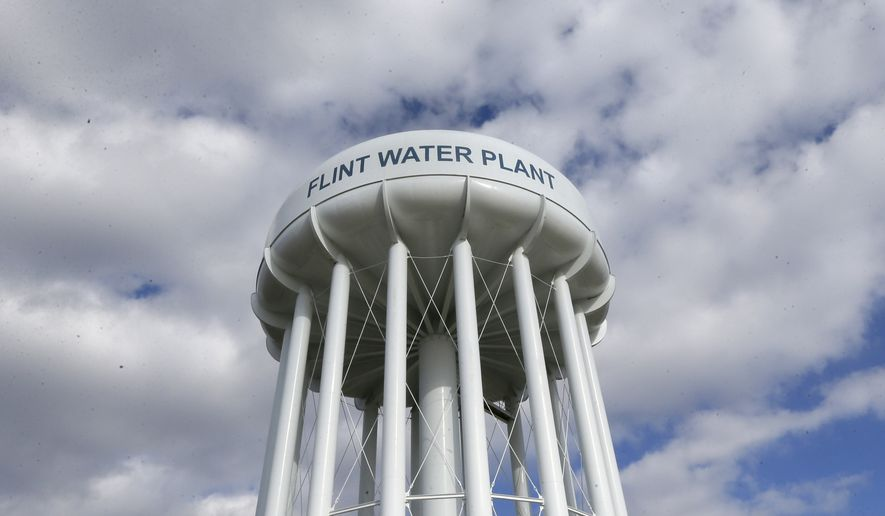 In this photo taken March 21, 2016, the Flint Water Plant water tower is seen in Flint, Mich. President Barack Obama next week will make his first trip to Flint, Mich. since the impoverished city was found to have lead-tainted drinking water, the White House said Wednesday, April 27, 2016.   (AP Photo/Carlos Osorio)