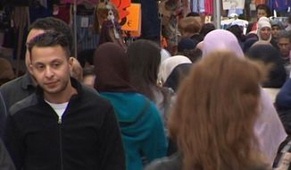 This Wednesday, April 13, 2016, file image taken from video shows Salah Abdeslam, left, the fugitive from the Nov. 13 Paris attacks whose capture appears to have precipitated the March 22 bombing in Brussels. Belgian prosecutors confirmed Wednesday, April 27, 2016, that Paris attacks suspect Salah Abdeslam was handed over to French authorities. (TVbrussels via AP)