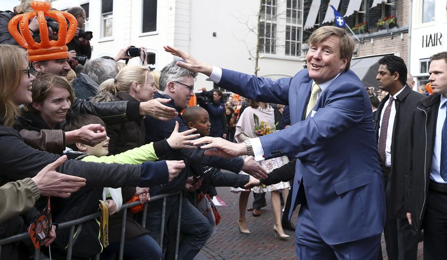 King Willem-Alexander greets well-wishers during King's Day celebrations in Zwolle, Netherlands, Wednesday April 27, 2016. The Dutch are marking their king's birthday with an official celebration in the northeastern city of Zwolle and festivals and unofficial garage sales around the nation. (Photo by Andreas Rentz, Pool)