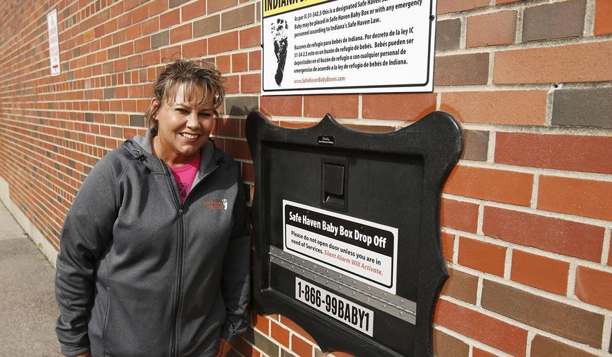 Monica Kelsey and the town of Woodburn, Ind., dedicated the first Safe Haven Baby Box of its kind on Tuesday, April 26, 2016, at the Woodburn Volunteer Fire Department. The box, which is temperature controlled and has a padded inside, is electronically monitored and sounds an alarm witht the fire station whenever the door is opened. (Chad Ryan/The Journal Gazette via AP)
