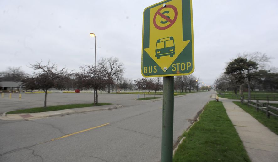 A DDOT bus stop sign is seen on Inselruhe Ave. near the Belle Isle Conservancy on Belle Isle in Detroit, Mich., on Tuesday, April 26, 2016. Detroit has resumed bus service to Belle Isle in a move that allows riders to visit the island park without paying the usual cost of entry. (Steve Perez/ The Detroit News via AP))