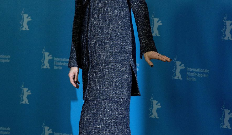 "FILE - In this Thursday, Feb. 11, 2016 file photo, actress Tilda Swinton leaves after a photo call for the film 'Hail Caesar' at the 2016 Berlinale Film Festival in Berlin, Germany. One of the screenwriters of the film ""Doctor Strange"" has suggested that the casting of British actress Tilda Swinton as sorcerer the Ancient One, who is a Tibetan male character in the ""Doctor Strange"" comic books, was partly done to avoid potentially offending China's government and moviegoers, who now represent the world's second-largest annual box office after North America. (AP Photo/Axel Schmidt, File)"