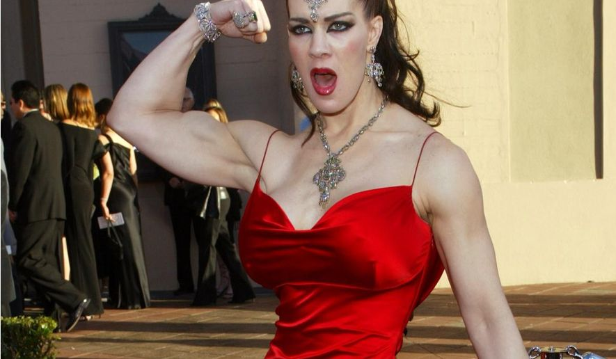 FILE - In this Nov. 16, 2003, file photo, Joanie Laurer, former pro wrestler known as Chyna, flexes her bicep as she arrives at the 31st annual American Music Awards, in Los Angeles. Chyna's manager, Anthony Anzaldo, says he believes the former wrestling star died of an accidental overdose of a prescription sleeping pill and a tranquilizer. Anzaldo found the body of the 46-year-old in bed at her Redondo Beach home on April 20, 2016. (AP Photo/Kevork Djansezian, File)