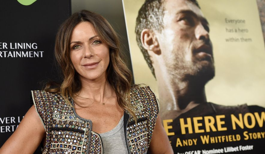 """FILE - In this April 5, 2016 file photo, Vashti Whitfield, widow of actor Andy Whitfield, poses at the premiere of the film """"Be Here Now (The Andy Whitfield Story),"""" in Beverly Hills, Calif. Andy Whitfield died of non-Hodgkin lymphoma in 2011. (Photo by Chris Pizzello/Invision/AP, File)"""