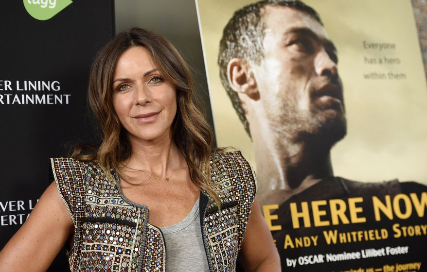"FILE - In this April 5, 2016 file photo, Vashti Whitfield, widow of actor Andy Whitfield, poses at the premiere of the film ""Be Here Now (The Andy Whitfield Story),"" in Beverly Hills, Calif. Andy Whitfield died of non-Hodgkin lymphoma in 2011. (Photo by Chris Pizzello/Invision/AP, File)"