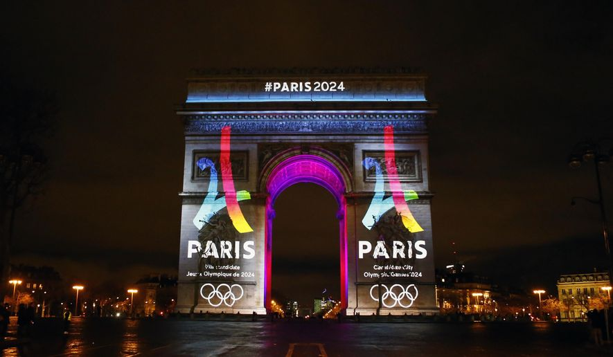 FILE - A Tuesday, Feb. 9, 2016 photo from files showing the Eiffel Tower-shaped logo for the Paris 2024 bid being unveiled on The Arc of Triomphe on the Champs Elysees in Paris. The head of France's Olympic committee said Wednesday, April 27, 2016, that hosting a successful European Championship in June and July would provide further proof that the country could stage the games safely in 2024. (AP Photo/Francois Mori, File)