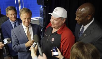 Tennessee Gov. Bill Haslam, second from left, talks with reporters after an announcement Wednesday, April 27, 2016, in Spring Hill, Tenn., that General Motors will invest $790 million at its plant in Spring Hill and another $118 million in Bay City, Mich. (AP Photo/Mark Humphrey) ** FILE **