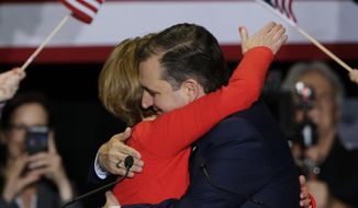 Republican presidential candidate Sen. Ted Cruz, R-Texas, hugs former Hewlett-Packard CEO Carly Fiorina during a rally in Indianapolis, Wednesday, April 27, 2016, where he announced he has tapped Fiorina as his running mate. (AP Photo/Michael Conroy)
