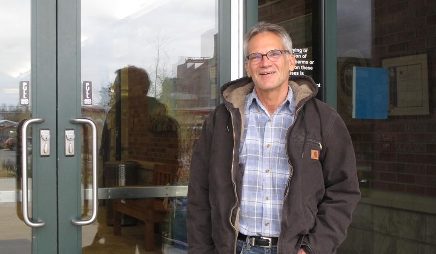 """Into the Wild"" author Jon Krakauer comments on his lawsuit against Montana's higher education commissioner in Bozeman, Mont., on Tuesday, April 26, 2016. (AP Photo/Matt Volz)"