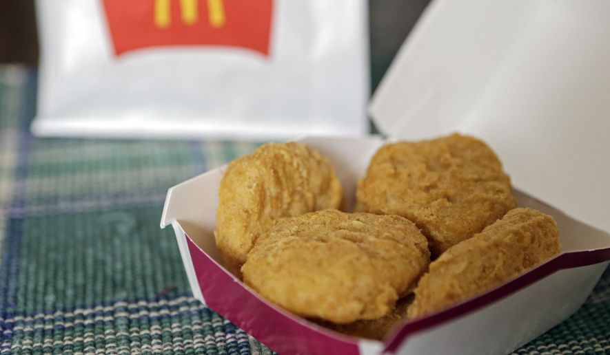 In this March 4, 2015 file photo, an order of McDonald's Chicken McNuggets is displayed for a photo in Olmsted Falls, Ohio. (AP Photo/Mark Duncan)