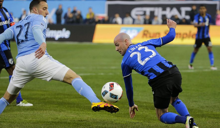 Montreal Impact's Laurent Ciman (23) defends New York City FC's RJ Allen (27) during the first half of an MLS soccer match Wednesday, April 27, 2016, at Yankee Stadium in New York. (AP Photo/Frank Franklin II)