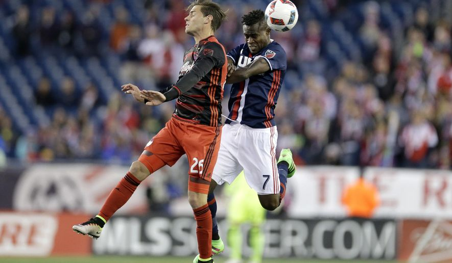 Portland Timbers' Lucas Melano (26) and New England Revolution's Gershon Koffie (7) vie for control of the ball during the first half of an MLS soccer game Wednesday, April 27, 2016, in Foxborough, Mass. (AP Photo/Steven Senne)
