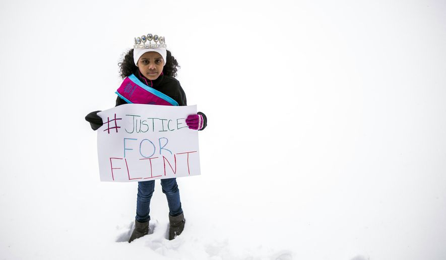 "In a March 6, 2016 photo, Mari Copeny, 8, of Flint, Mich., stands with a protest sign during a #Justice4Flint rally at Wilson Park on University of Michigan-Flint's campus in Flint, Mich. The White House announced Obama's first visit to Flint Wednesday, April 27, 2016, by posting online a letter the president wrote to Amariyanna ""Mari"" Copeny. The 8-year-old activist known as ""Little Miss Flint"" wrote to the president to tell him she was coming to Washington to push lawmakers to do more for the city. (Jake May/The Flint Journal-MLive.com via AP)"