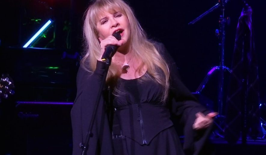"""This image made from video shows singer Stevie Nicks singing """"Rhiannon"""" during a surprise performance after the curtain call for the musical  """"School of Rock,"""" Tuesday, April 26, 2016, in New York. (AP Photo/Bruce Barton)"""