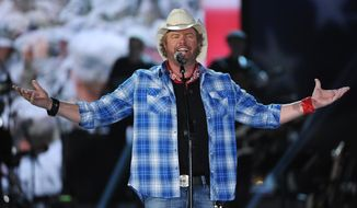 In this April 7, 2014, file photo shows Toby Keith performs at ACM Presents an All-Star Salute to the Troops  in Las Vegas. (Photo by Chris Pizzello/Invision/AP, File)