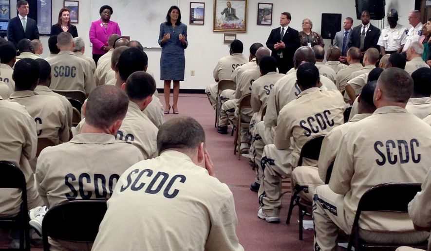 South Carolina Gov. Nikki Haley talks to inmates at Manning Correctional institution Monday, April 25, 2016, in Columbia, S.C., who are scheduled to be released. Haley told prisoners Monday a better life beyond the barbed-wire fencing starts with a legal job, and it's her job to help them find one. (AP Photo/Seanna Adcox)
