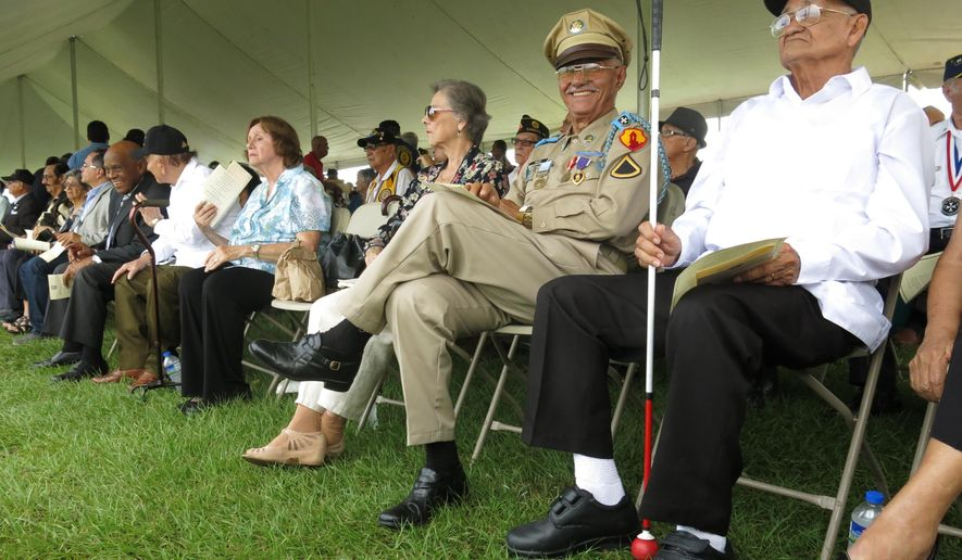 Puerto Rico war veterans await for their Congressional Gold Medal at a ceremony in San Juan, Puerto Rico on Wednesday, April 27, 2016. The veterans were part of the 65th Infantry Regiment known as the Borinqueneers, which faced discrimination and was the last segregated unit in combat. (AP Photo/Danica Coto)
