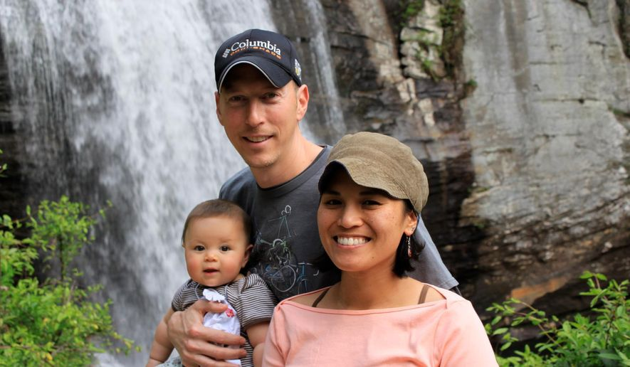 In this 2012 photo provided by Jamie Gilpin, Gilpin, center, poses for a photo with his wife, Joy Cadelina Gilpin, right, and daughter, Celeste Gilpin, at Looking Glass Falls, Pisgah National Forest, near Asheville, N.C. Small businesses in North Carolina are worried about fallout from the new state law limiting protections for gay, lesbian, bisexual and transgender people. Jamie Gilpin said that his bicycle tours business has seen a decline in inquiries since the law was passed. (Jim Gilpin/Courtesy of Jamie Gilpin via AP) MANDATORY CREDIT