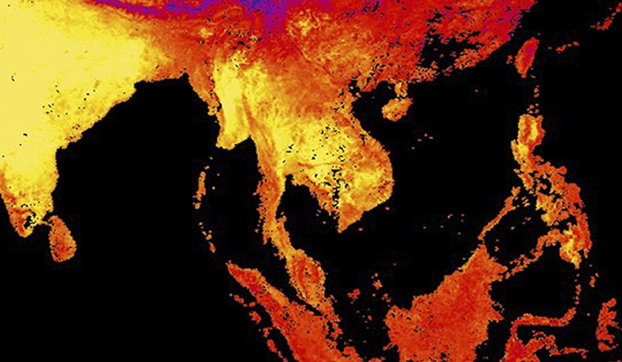 This image released by NASA's Earth Observatory Team from data collected by the Moderate Resolution Imaging Spectroradiometer (MODIS), an instrument on NASA's Terra and Aqua satellites, shows the land surface temperature as observed by MODIS in Thailand, center, and surrounding countries between April 15 to April 23, 2016. Yellow shows the warmest temperatures. April in Thailand is typically hot and sweaty but his year's scorching weather has set a record for the longest heat wave in at least 65 years. (Reto Stockli/NASA Earth Observatory Team/MODIS Land Science Team via AP) MANDATORY CREDIT