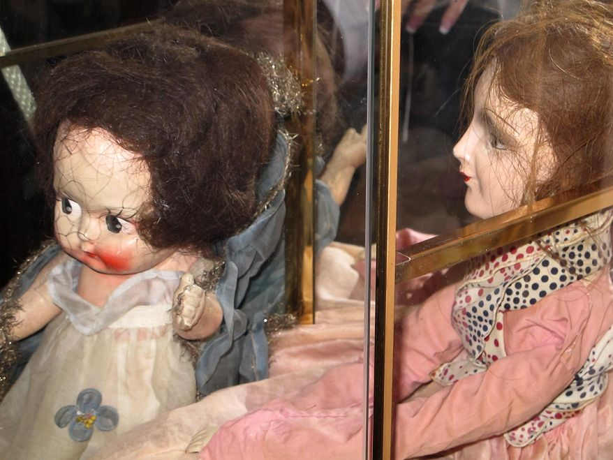 In this April 15, 2016 photo, antique dolls are displayed at the Palmyra, N.Y., Historic Museum, which has added ghost hunts to its educational tours. The museum is one of nearly 70 stops along New York's Haunted History Trail, which maps out places where there have been claims of paranormal activity and invites tourists to see for themselves. (AP Photo/Carolyn Thompson)