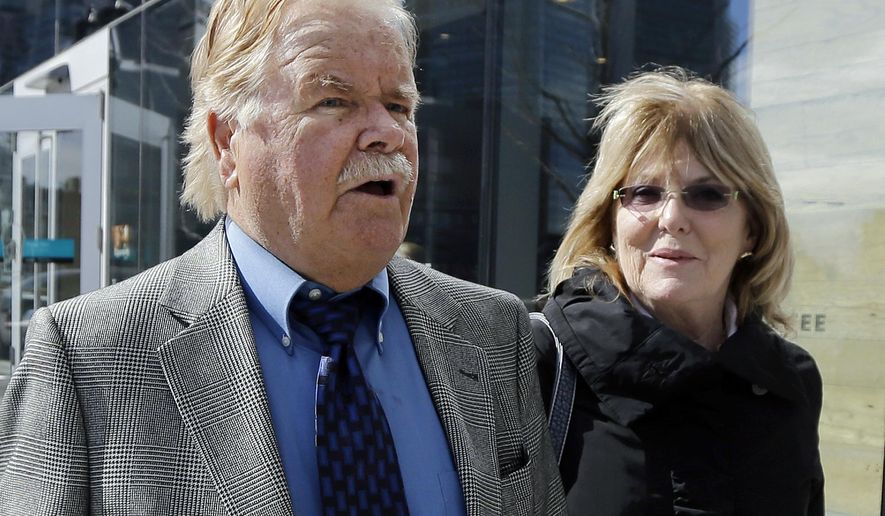 """FILE - In this April 30, 2015 file photo, Robert Fitzpatrick, of Charlestown, R.I., walks from federal court in Boston with his wife Jane. Fitzpatrick, a former FBI agent, pleaded not guilty to charges of perjury during James """"Whitey"""" Bulger's trial. Lawyers for Fitzpatrick and federal prosecutors filed papers in court Wednesday, April 27, 2016, asking a judge to schedule a change-of-plea hearing for May 5. (AP Photo/Elise Amendola)"""