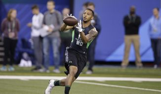 Texas Christian receiver Josh Doctson runs a drill at the NFL football scouting combine on Saturday, Feb. 27, 2016, in Indianapolis. (AP Photo/Darron Cummings)