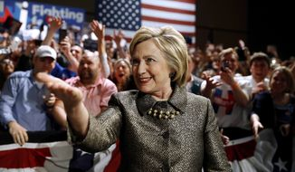FILE - In this April 26, 2016 file photo, Democratic presidential candidate Hillary Clinton moves to the stage at her presidential primary election night rally in Philadelphia. Bernie Sanders defied expectations to turn his long-shot presidential bid into a real threat for the Democratic nomination. But as his path to the White House becomes all-but-impossible, some of his supporters are lashing out at a system they believe was engineered against them from the start. (AP Photo/Matt Rourke, File)