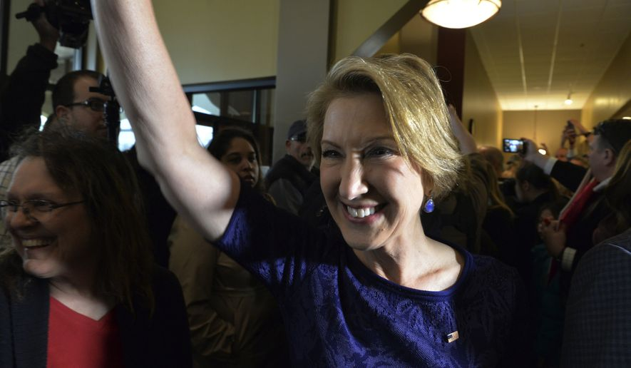 Carly Fiorina reacts to supporters inside a restaurant in Elkhart, Ind., as she campaigns with Republican presidential candidate Sen. Ted Cruz, R-Texas, Thursday April 28, 2016, as Cruz and his vice presidential choice Fiorina greeted supporters. (AP Photo/Joe Raymond)