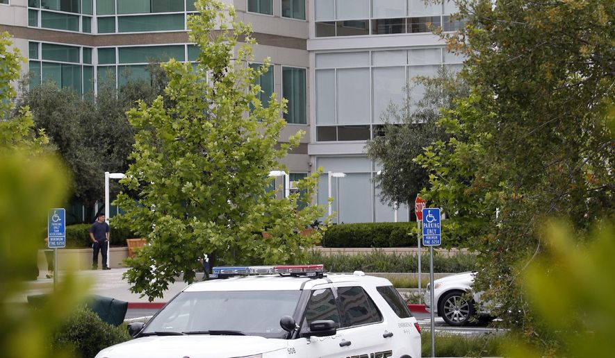 Santa Clara County Sheriff's deputies investigate a report of a body found at Apple headquarters Wednesday morning April 27, 2016, in Cupertino, Calif. (Karl Mondon/Bay Area News Group via AP)