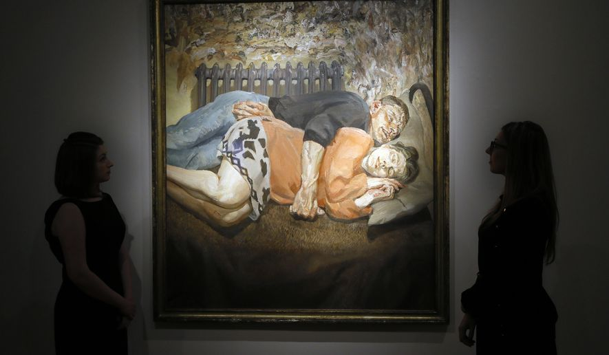 Christie's employees look towards a family portrait from 1992 by Lucian Freud, at their auction rooms in London, Thursday, April 28, 2016. The painting valued at 18 million UK pounds (26.25 million US dollars) will be auctioned on June 30 in the Defining British Art sale. (AP Photo/Kirsty Wigglesworth)