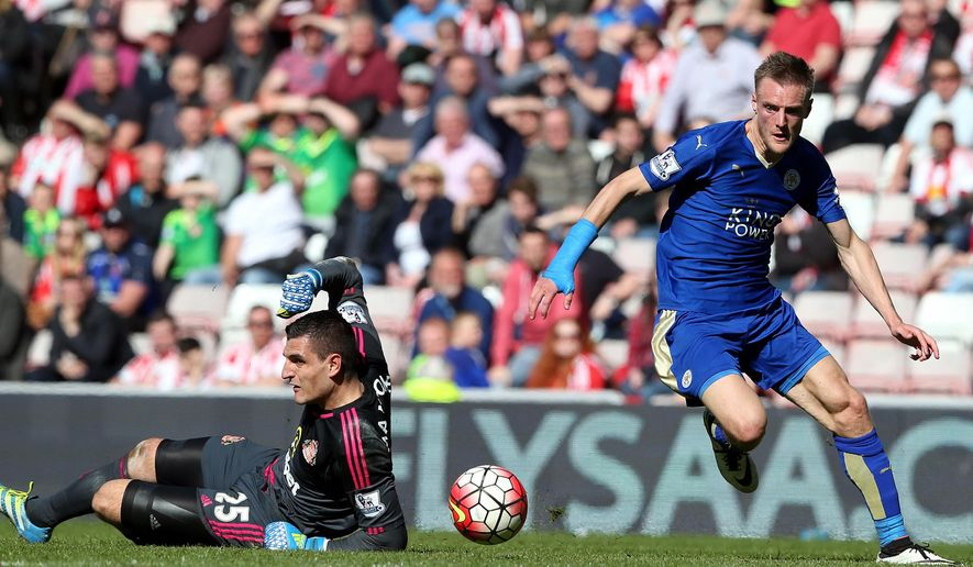 FILE - In this Sunday, April 10, 2016 file photo Leicester City's Jamie Vardy, right, goes on to score his goal past Sunderland's goalkeeper Vito Mannone, left, during the English Premier League soccer match between Sunderland and Leicester City at the Stadium of Light, Sunderland, England. Four years ago, Vardy was playing for Fleetwood Town, a team outside the four professional leagues in England. Now he is a Premier League record breaker after scoring in 11 consecutive matches this season. He has spearheaded Leicester's title charge with 22 goals and is now set to go to the European Championship with England. (AP Photo/Scott Heppell, File)