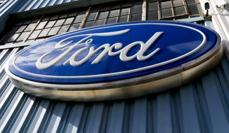 This Thursday, Nov. 19, 2015, photo, shows a Ford sign above the entrance to Butler County Ford in Butler, Pa. Ford reports financial results Thursday, April 28, 2016. (AP Photo/Keith Srakocic) **FILE**