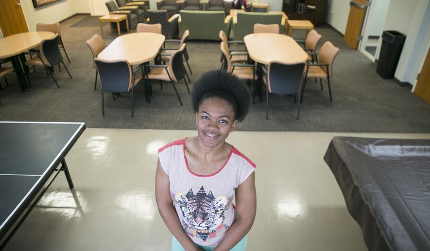 Shania Williams poses at Kinsolving Dormitroy on Monday, April 18, 2016 in Austin, Texas. Williams is a part of a growing number of high school graduates who has credits that are lost in college, she doesn't regret taking the classes that she did because they piqued her interest. (Ricardo Brazziell/Austin American-Statesman via AP)  AUSTIN CHRONICLE OUT, COMMUNITY IMPACT OUT, INTERNET AND TV MUST CREDIT PHOTOGRAPHER AND STATESMAN.COM, MAGS OUT; MANDATORY CREDIT