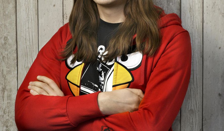 """This undated image released by Rovio Entertainment shows Miika Tams, vice president of games at Espoo, Finland-based studio Rovio, which is dropping a code in the credits of the upcoming animated film, """"The Angry Birds Movie,"""" inspired by the mobile gaming sensation that will hatch an exclusive level for a new pinball-inspired game called """"Angry Birds Action!"""" A level set on Piggy Island, home to the Angry Birds' snout-faced adversaries, can only be unlocked if players pluck out their mobile devices and zap a code displayed during the film's credits when it debuts May 20. (Rovio Entertainment via AP)"""