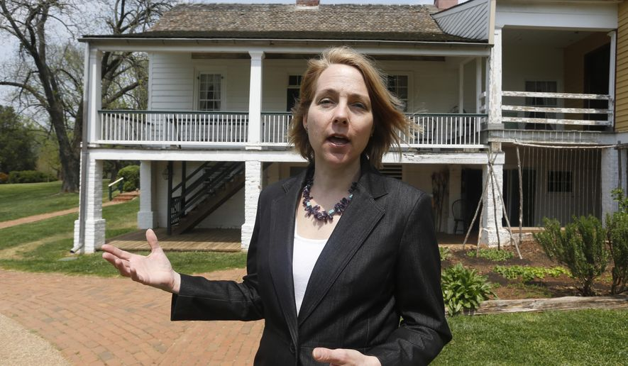 In this Thursday, April 21, 2016 photo, Executive Director of The James Monroe Highland Foundation, Sara Bon-Harper, gestures in front what was considered the home of former President James Monroe in Charlottesville, Va. The house which is shown from the back was a guest house built in 1818. (AP Photo/Steve Helber)