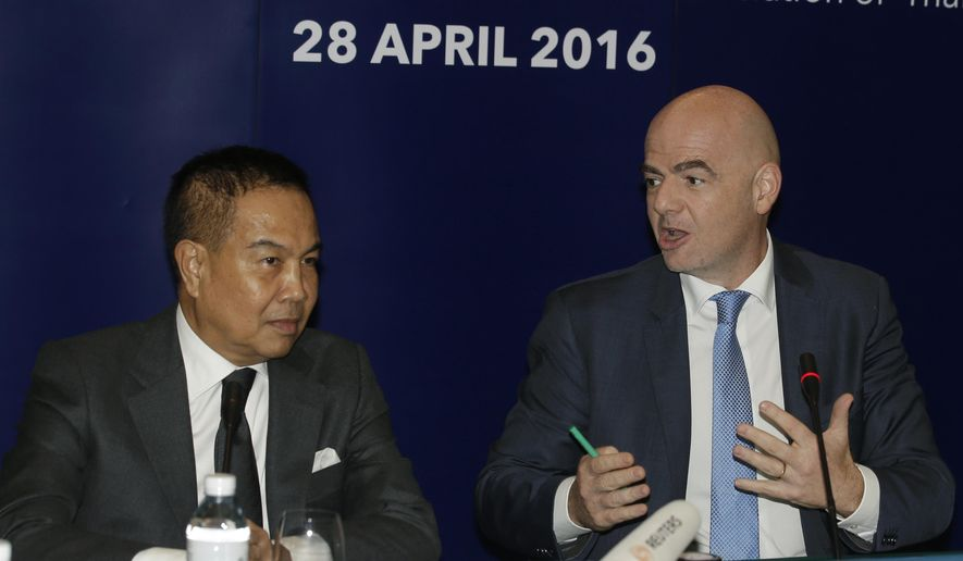 FIFA President Gianni Infantino, right, talks to President Football Association of Thailand Somyot Poompanmoung during a press conference in Bangkok, Thailand, Thursday, April 28, 2016. Infantino takes part in the celebrations of the 100th anniversary of the Football Association of Thailand. (AP Photo/Sakchai Lalit)