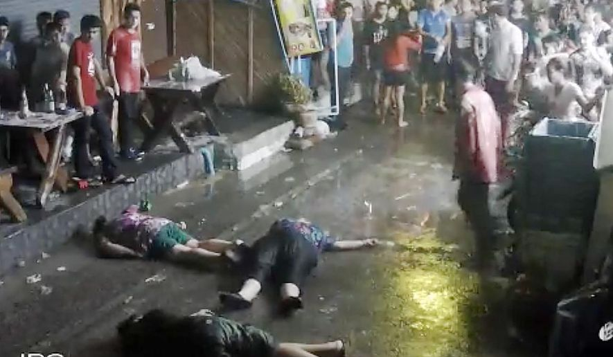 In this April 13, 2016 image taken from video released by the Hua Hin Municipality, an elderly British couple and their son are on the ground after they were savagely attacked during a family vacation in Hua, Hin, Thailand. A video of the attack, which was captured by overhead security cameras and posted this week on social media, has stirred shock and outrage over its brutality and the ages of the elder victims, a 65-year-old woman and 68-year-old man from Scotland. The attack marks the latest act of violence against tourists in the Southeast Asian country. (Hua Hin Municipality via AP)