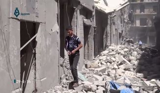 This image made from video released by Qasion News Agency, a media opposition platform that relies on a network of activists on the ground, on Friday, April 29, 2016, shows the rubble following airstrikes in Aleppo, Syria. (Qasion News Agency via AP)