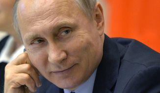 Russian President Vladimir Putin attends a meeting with members of the Legislative Council in St. Petersburg, Russia, Friday, April 29, 2016. (Alexei Druzhinin/Sputnik, Kremlin Pool Photo via AP) ** FILE **
