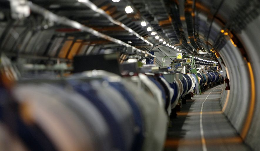 """A May 31, 2007, file photo shows a view of the Large Hadron Collider in its tunnel at the European Particle Physics Laboratory, CERN, near Geneva, Switzerland. It's one of the physics world's most complex machines, and it has been immobilized """"temporarily"""" by a weasel. (Martial Trezzini/Keystone via AP, File)"""