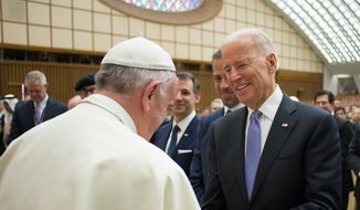 Pope Francis shakes hands with US vice president Joe Biden as he takes part at a congress on the progress of regenerative medicine and its cultural impact, being held in the Pope Paul VI hall at the Vatican, Friday, April 29, 2016. (L'Osservatore Romano/Pool photo via AP)