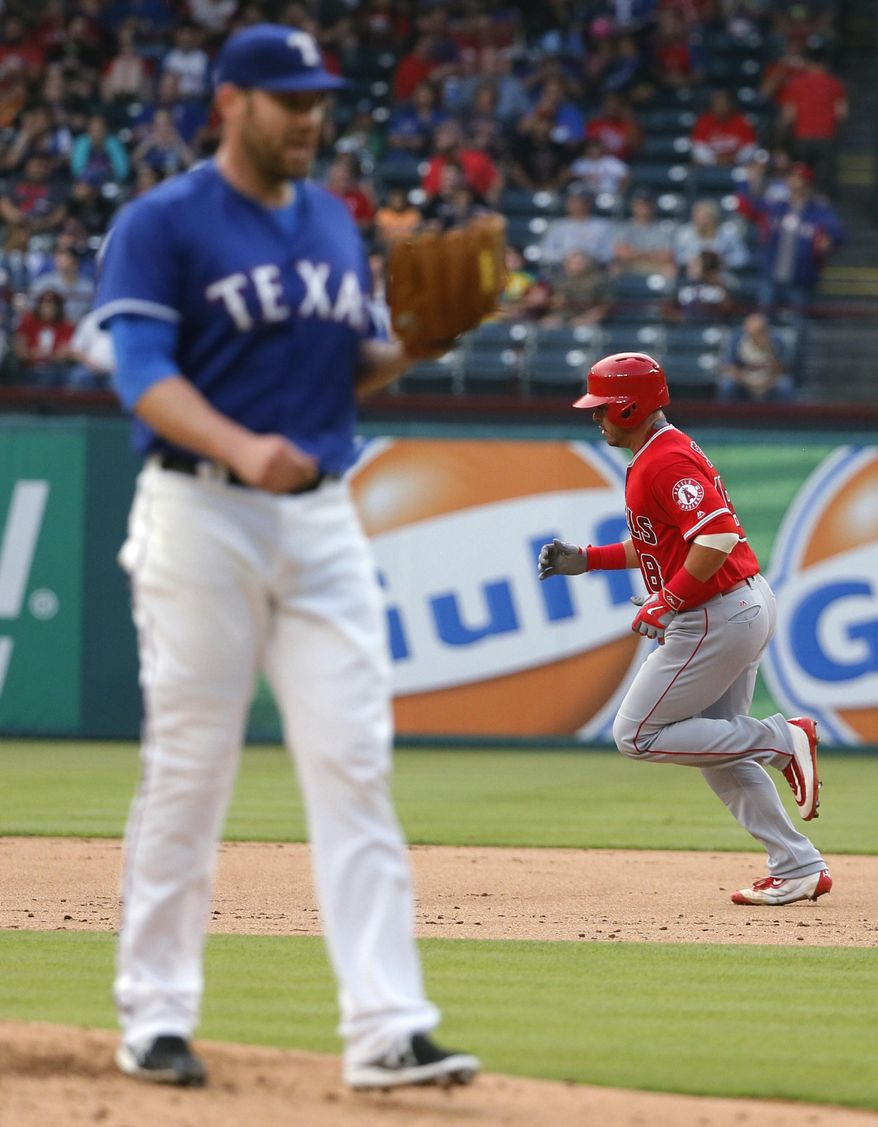 Texas Rangers starting pitcher Colby Lewis (48) stands on the mound as Los Angeles Angels' Geovany Soto rounds the bases following his solo home run off of Lewis during the third inning of a baseball game, Friday, April 29, 2016, in Arlington, Texas. (AP Photo/Tony Gutierrez)