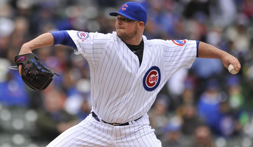Chicago Cubs starter Jon Lester delivers a pitch during the first inning of a baseball game against the Atlanta Braves Friday, April 29, 2016, in Chicago. (AP Photo/Paul Beaty)