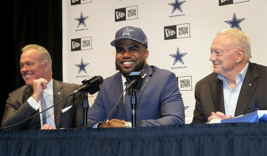 Dallas Cowboys Director of Player Personnel Stephen Jones, left, and team owner Jerry Jones, right, listen as first-round draft pick Ezekiel Elliott, center, answers questions at a news conference at the NFL football team's facility, Friday, April 29, 2016, in Irving, Texas. (AP Photo/Tony Gutierrez)